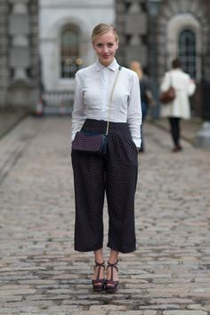 Consider it the new shape of things. The street style set is showing off their ankles in wide leg pants that don't quite hit the floor—yet take the Bermuda short just a little further.   - HarpersBAZAAR.com