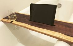Live edge walnut wood bath tray, bath caddy with tablet, iPad holder and wine holders by 56 Woodworks. Perfect for relaxing after a long day with Netflix and wine. 56woodworks.etsy.com