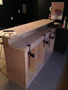 DIY Bar tutorial. This sure would be cool in my basement;) **Instead of Bar, make it a 2-tiered kitchen island w/stools, perfect!  can't find just the right size for our kitchen, so let's make it!