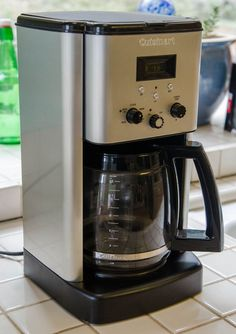 Cleaning a coffee maker-or 1 part vinegar 2 parts water, scrub pot with baking powder and