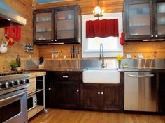 Pretty and warm kitchen. Love the wood with the stainless counter top with small stainless back splash piece.