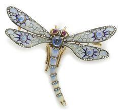 A plique-à-jour enamel, sapphire, ruby and diamond articulated dragonfly brooch. | © Bonhams 2001-2014