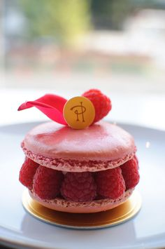 Pierre Herme Ispahan - Rose flavored macaron with a rose petal on top, raspberries and raspberry creme with essence of rose....