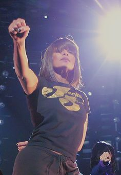 Janet performing. Love the t-shirt.