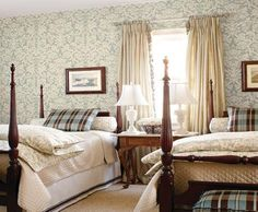 Today's favorite guest bedroom:  Love the mix of feminine + masculine; duvets; wallpaper; bolsters; plaid; bedskirts - charming + old fashioned but not outdated