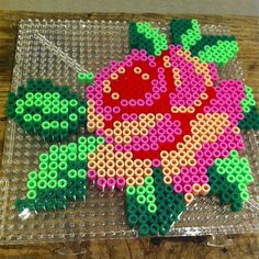 Rose flower perler beads by elinorleijon Hama Beads Design, Diy Perler Beads, Perler Bead Art, Pearler Beads, Pixel Art, Pearler Bead Patterns, Perler Patterns, Art Perle, Bead Crafts