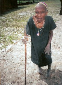 West Papual Indonesia (Irian Jaya)  The matriarch of the village. It is inappropriate to ask the name and they do not keep records of age. She was sure to show me her hand when we first met. Women cut off their fingers as a sign of mourning. She is proudly wearing the dogtag I gave to here.   Photo by Elisa Kotin