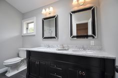 Double Vanity with Marble Top, Chrome Fixtures, elongated toilet bowl.