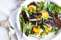 Create the perfect meat-free winter meal with this roasted mushroom and haloumi salad served with crispy lentils and spinach pesto.