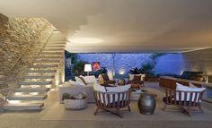 diseño de interiores en casa: Una bella casa en Ilhabela, por Marcio Kogan