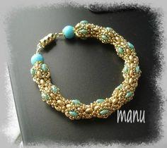 Design by Vezsuzi, beaded by Manu. Beautiful bracelet!