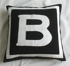 monogrammed pillows custom made -20 inches custom made black and white only. $28.99, via Etsy.
