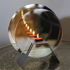 Infinity candle uses round mirrors and candlelight to create a stunning optical illusion. An unusual lighting feature, buy infinity candle at The Glow Company Glass Tea Light Holders, Tealight Candle Holders, Candle Jars, Mirror Candle, Candle Gifts, Infinity Lights, Infinity Mirror, Infinity Spiegel, The Glow Company