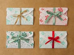 DIY Gift Card Evelopes With Paper Dollies >> http://www.diynetwork.com/home/7-unique-ways-to-wrap-gifts/pictures/index.html?soc=hpp