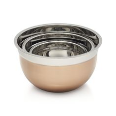 Shop Copper Mixing Bowl Set of Three.  All-purpose mixing bowls take a shine to mixed metallics, featuring matte copper exteriors and polished stainless steel interiors.  The flat base provides stability and balance for kitchen prep and tableside serving.