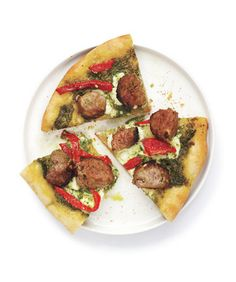 Meatball Pizza With Pesto: Creamy ricotta, pungent pesto, and roasted peppers dress up an anything-but-ordinary meatball pie.