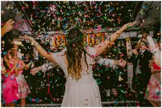 Guests go wild for wedding dancefloor confetti canons - just remember to give your wedding photographer heads up to get the shot! #weddingideas #boho #inspiration #weddingreception #festivalwedding #hippy Images copyright Lucabella. www.lucabella.co.uk