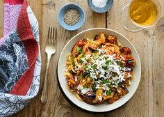 This traditional Sicilian pasta dish of sautéed eggplant tossed with tomato sauce and topped with ricotta salata makes for a satisfying vegetarian dinner, and it can be thrown together in under an hour.