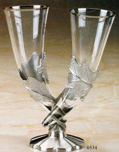 "Entwined Oak Wedding glasses. The glass slides out of the oak leaf ""cradles""."