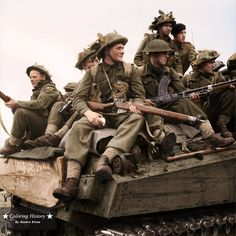 British infantry armed with Lee Enfields (SMLE) and a Bren Gun ride on a Sherman tank of the 11th Armoured Division in Holland, 24th September 1944.