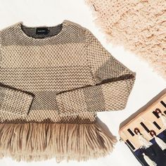 fun fringe sweater--great with black pants and over the knee boots