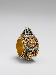 Jewish Betrothal Ring from the 17th or 19th century.  The top opens with an inscription in Hebrew Mazel Tov.  Part of the Met, but not on display  http://www.metmuseum.org/collections/search-the-collections/120008425?img=0