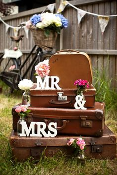 Adorable arrangements of vintage luggage, signs and flowers.  Pinned by Afloral.com from bristolvintageweddingfair.blogspot.co.uk ~Find decorations and flowers at Afloral.com to DIY your wedding.