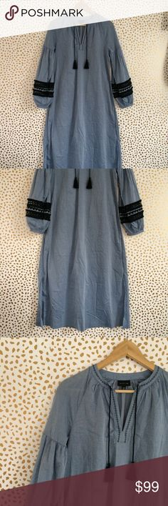 XS  Who What Wear Chambray Caftan XS  Who What Wear Chambray Caftan. Medium blue Chambray, black lace and  trim. BOHO. Longer length with side slit, tassel front detail, full sleeves, with lace detail and cuff. Model picture shows it Belted, however belt not included. New without tags, black line through label. Bundle for additional discounts and seller offers. Careful packaging, fast shipping. Who What Wear Dresses Maxi