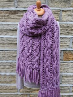 Tangle Scarf - Knit this wide accessory scarf designed exclusively for Knitrowan by Martin Storey. Using one of our most popular yarns Big Wool (wool), this scarf has a simple cable and lace design and fringing.