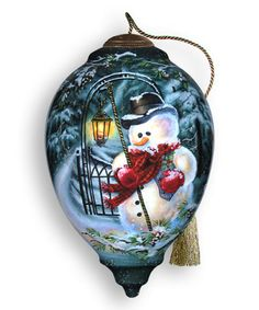 Snowy Magic Ornament by Ne'Qwa Art  Hand-blown and painted on the inside, this beautiful glass ornament comes packaged in a satin-lined keepsake box for a one-of-a-kind holiday gift.   Includes ornament and certificate of authenticity 5.5'' diameter Glass Imported  Snowman xmas christmas holidays ornaments