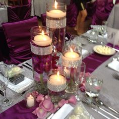 Purple wedding decor with orchids and candles Photo by flowersbyamore..Maybe  your colors in the runner, with the centerpiece in white with added bling? Just a thought...