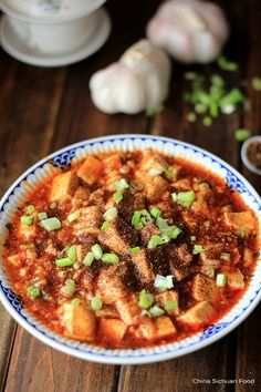 {China} Authentic Mapo tofu - spicy tofu with ground meat in a savory and numbing sauce | rasamalaysia.com
