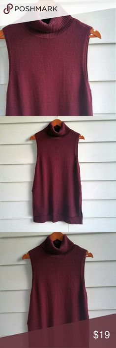 """WHBM Maroon Turtleneck Tunic A lovely maroon turtleneck tunic in beautiful gently used condition. Split side detail.   29"""" long shoulder to hem in front 33"""" long shoulder to hem in back  18.5"""" armpit to armpit 46% cotton, 44% nylon, 10% wool White House Black Market Tops Tunics"""