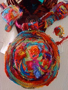 machine felting, machine embroidery, giant medallion with cord and felted beads by Amy Mimu Rubin