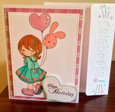 Birthday card using a stamped image and a couple spellbinder dies, colored with Copics and I also used a embossing folder and my cuttle bug. I used glossy accents on the shoes and hearts .