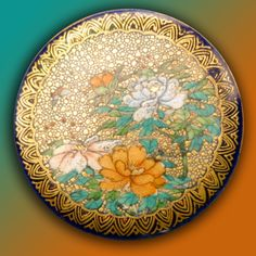Oriental Splendor May 9, 2016  A large and deluxe 19th century Satsuma button that has it all. A cobalt button literally covered with gold with Japanese peonies and greenery with an intricate gold border design. Sold for $266 in Spring 2010 Armchair Auction.