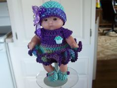 So adorable in her purple/lavender/aqua dress with cupcake trim. # 191