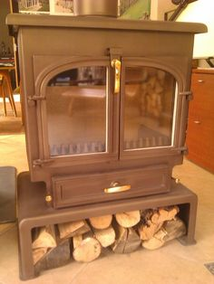 Clearview 650 flat top wood burner with Clearview plinth/log store - in Golden Fire Brown