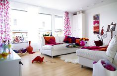 White Living Room With Pink And Orange Accents