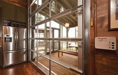 Love it!!! View of a glass garage door that leads to a screened porch. Get the look with a Clopay Avante Collection door at www.clopaydoor.com.