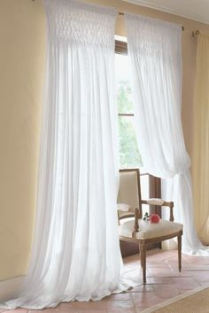 These curtains make me think of warm spring day with a cool breeze blowing throught the open window!
