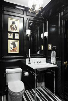 Glossy black & white powder room by Rob Stuart.