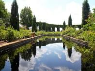 The Italian Garden  features two long reflecting pools bordered by Shipman's signature flower borders, as well as a ficus-covered gloriette, a traditional folly and a lion motif. The famous water gardens at the Villa Gamberaia in Tuscany were an inspiration for the design.