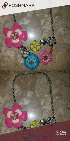 STATEMENT NECKLACE!!! Drop necklace! Flower gems. Multi colored gems. This is fun and flirty. Beautiful addition to the jewellery collection. Jewelry