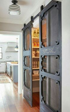 Vintage screen doors turned barn slider style pantry doors!