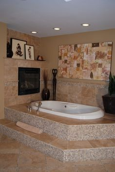 I long to have a fireplace next to my huge bathtub! Just TRY to get me out of the bath.