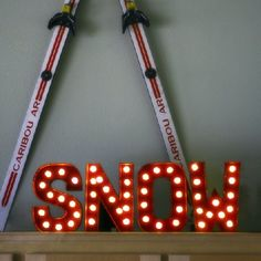 DIY Marquee sign using paper mache letters from JoAnns and LED globe lights.