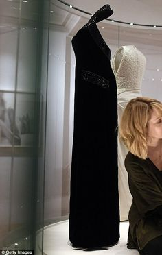 Princess Diana wore this Catherine Walker black halter-neck at Versailles in 1994 and will also be on display at the palace. It is one of the many evening gowns on display at the palace