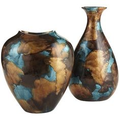 'These vases weren't always so rich with color. Black glaze and layers of gold leaf washed with turquoise and amber created their two-toned finish. And since they're handcrafted, each vase is an original that can stand alone or be grouped with other accessories. Now your home is rich with color, too.'