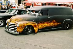 1953 Chevy panel van , lowered , black primer w/ custom flame paint